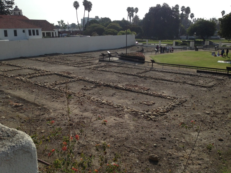 "Original foundations of the Mission Buildings. The ""new"" mission is just beyond the wall."